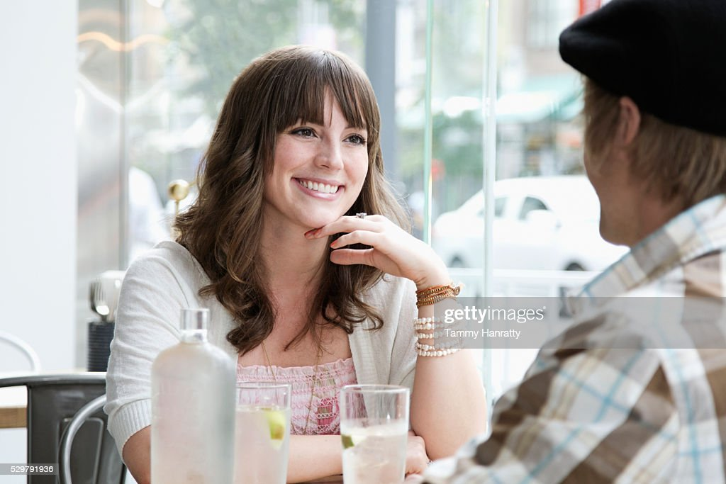 Man and woman sitting at restaurant : Stock Photo