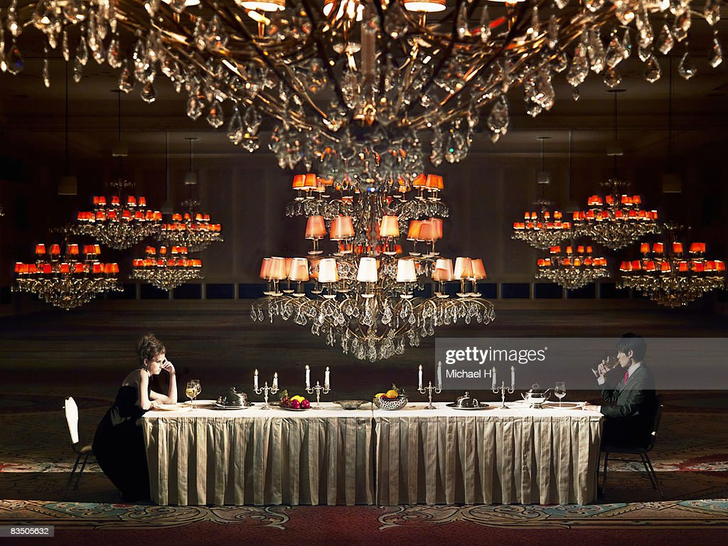 Man and woman sitting  in a ballroom : Stock Photo