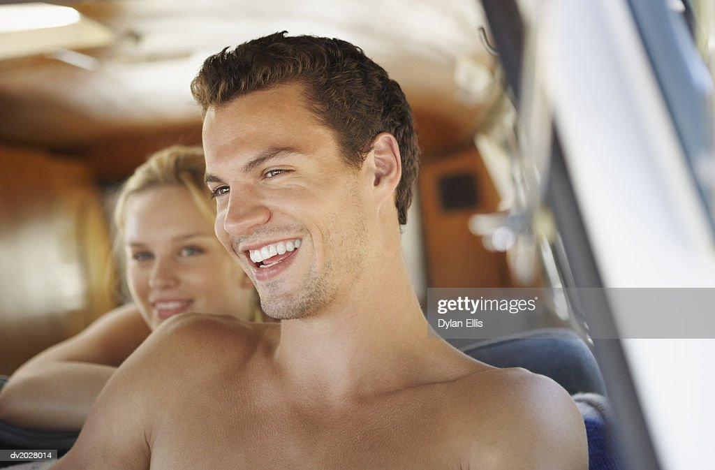 Man and woman Sitting in a Motor Home : Stock Photo