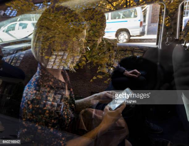 Man and woman sitting in car, view through window