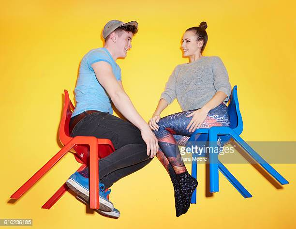 man and woman sitting next to each other