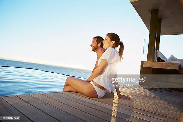 Man and woman sitting side by side