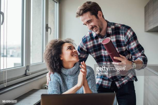 man and woman smiling and looking at each other - diploma stock pictures, royalty-free photos & images