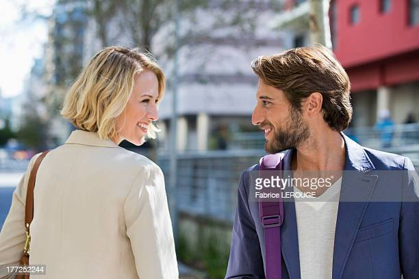 man and woman smiling at each other - love at first sight stock pictures, royalty-free photos & images