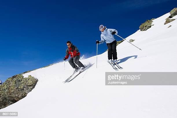 Man and woman snow skiing