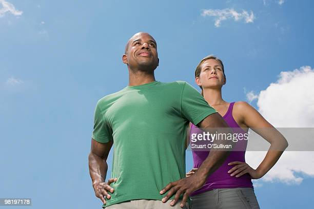 Man and woman standing against sky