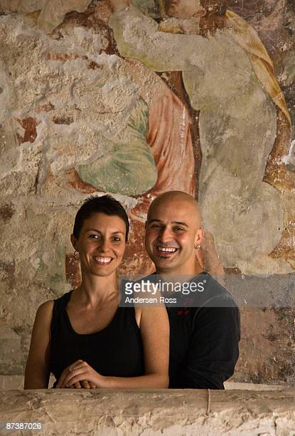 Man and woman standing at fresco