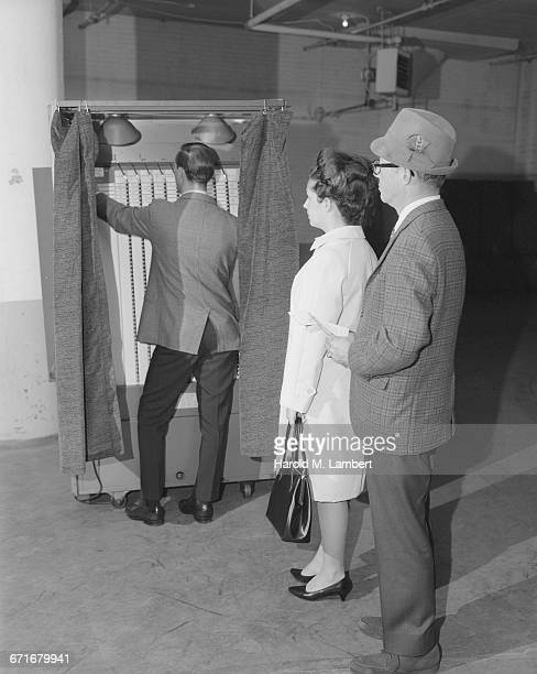 man and woman standing at voter machine - {{ contactusnotification.cta }} stock pictures, royalty-free photos & images
