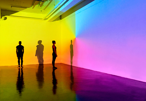 man and woman standing in a gallery space with colourful walls - gettyimageskorea