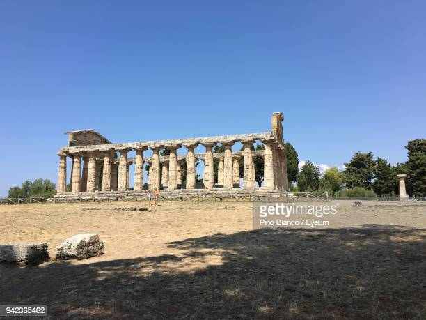 Man And Woman Standing In Front Of Second Temple Of Hera