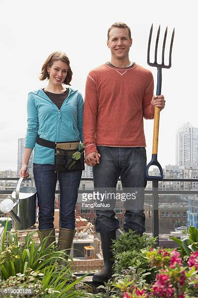Man and woman standing on roof garden
