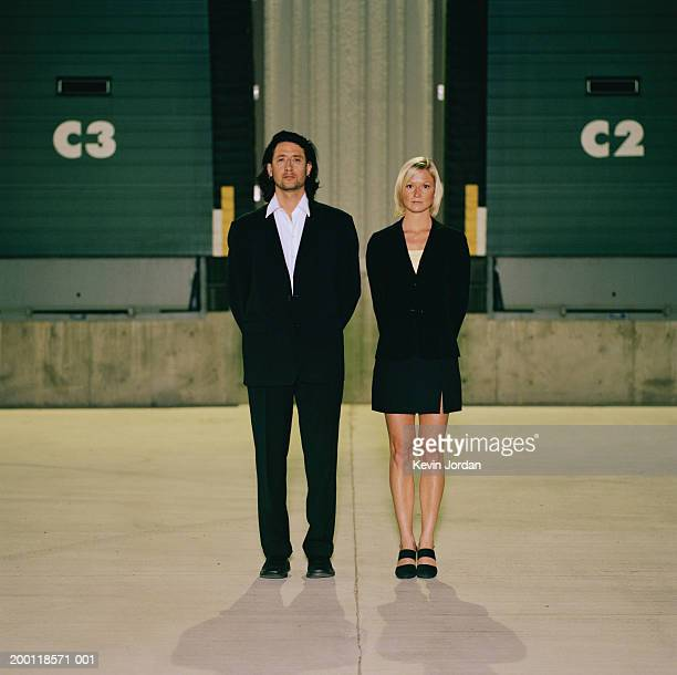 man and woman standing side by side, in loading dock, portrait - side by side stock photos and pictures