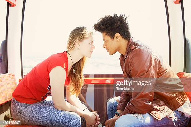 man and woman staring at each other in cable car - confrontation stock pictures, royalty-free photos & images