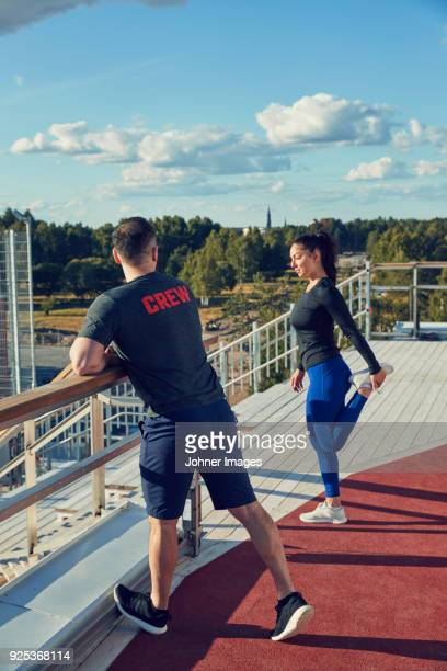 man and woman stretching - all weather running track stock pictures, royalty-free photos & images