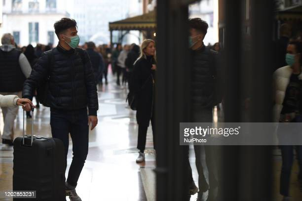 Man and woman stroll through the city with protective masks and sanitizing gels to counteract the possible infection of the ''CoronaVirus''MilanItaly...