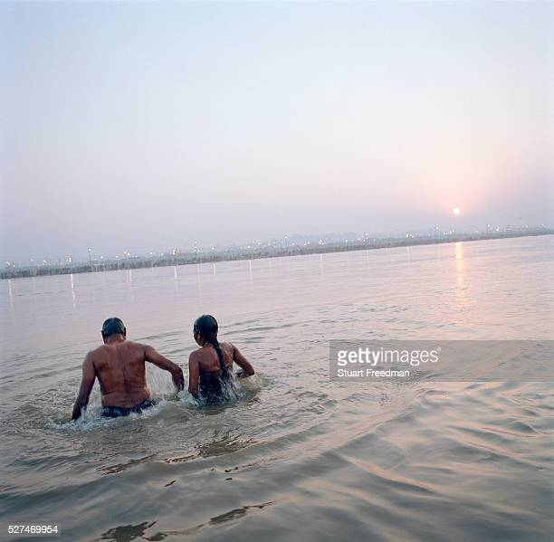 A man and woman take a ritual bath in the Rivers Ganges and Yamuna The Kumbh Mela is a mass Hindu pilgrimage occuring four times every twelve years...