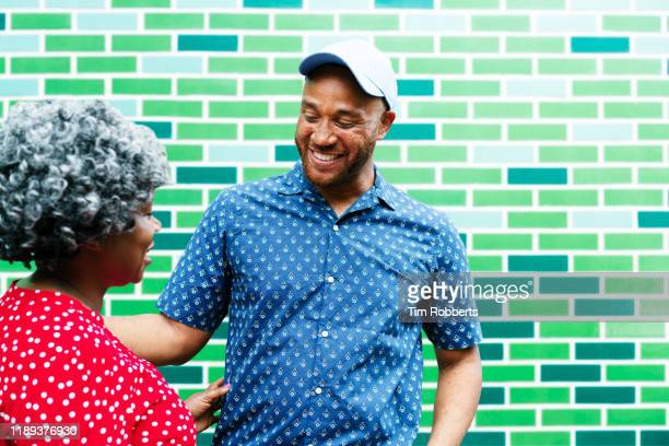 man and woman talking and hanging out - affectionate stock pictures, royalty-free photos & images
