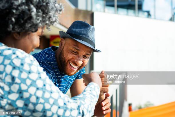 man and woman talking and smiling together - communication stock pictures, royalty-free photos & images