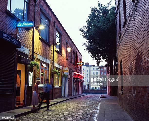 Man and woman talking in an alleyway in Dublin, Ireland