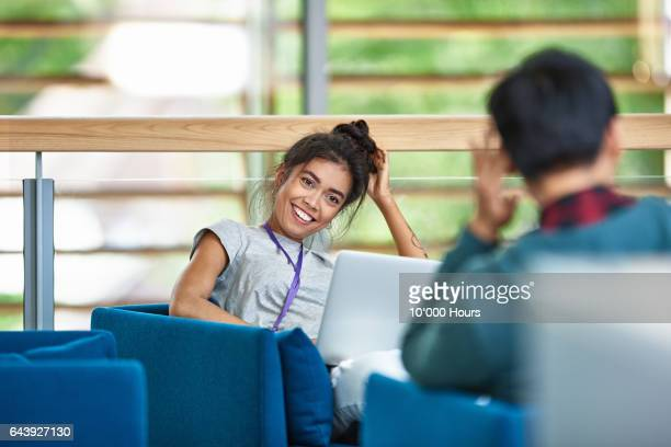 man and woman talking in modern office. - vanguardians stock pictures, royalty-free photos & images