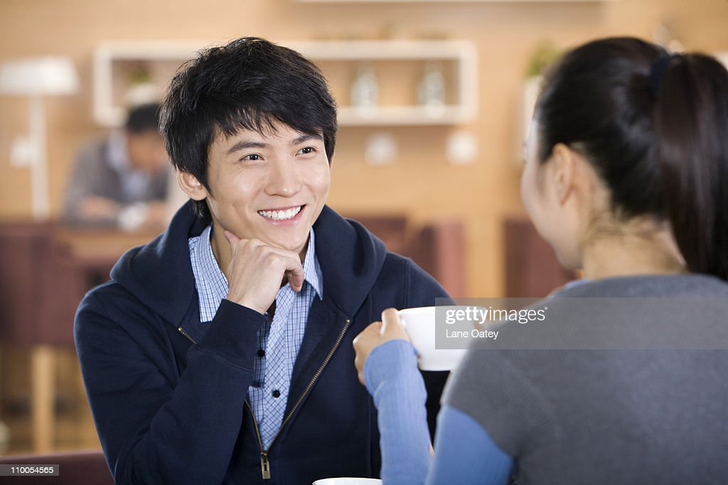 Man and woman talking over coffee : Stock Photo