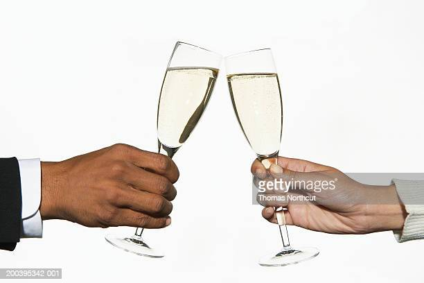 Man and woman toasting champagne, close-up