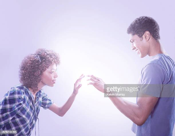 Man and woman touching fingers