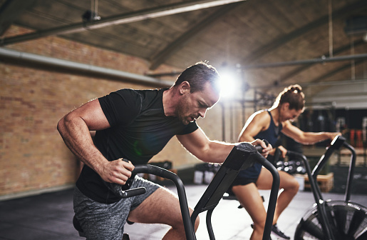 Man and woman training with gym equipment 891604422