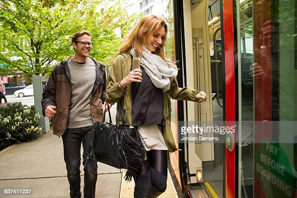 A man and woman using the street car.
