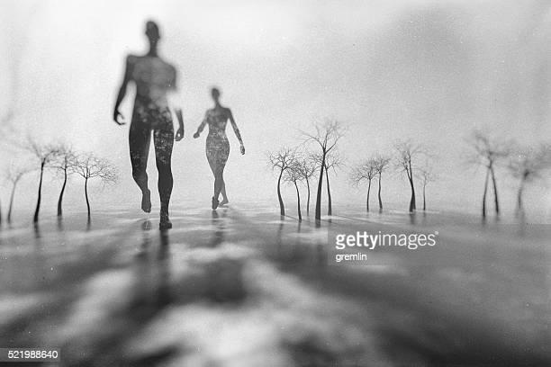 Homem e mulher andar na fantasia de inverno Paisagem