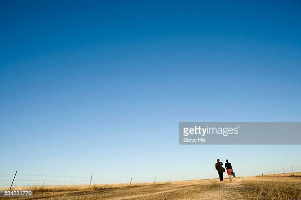 Man and Woman Walking on a Country Road