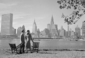 man woman standing looking at nyc