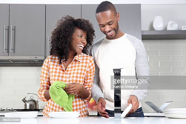 Man and woman washing dishes.