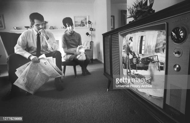 Man and Woman watching Film Footage of Vietnam war on Television in their Living Room Warren K Leffler February 13 1968