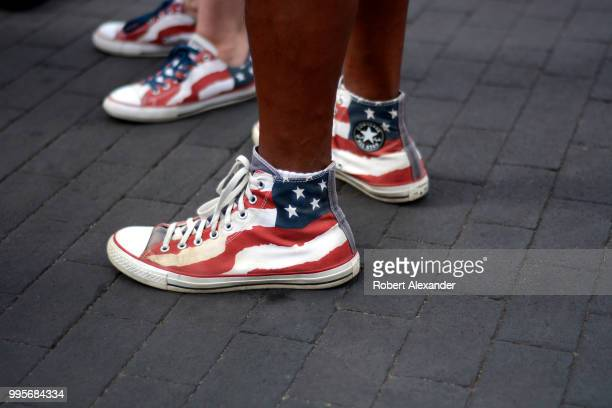 A man and woman wear 'stars and stripes' Converse Chuck Taylor All Star high top shoes as they enjoy a Fourth of July holiday celebration in Santa Fe...