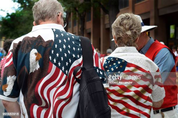 A man and woman wearing patriotic 'stars and stipes' shirts enjoy a Fourth of July holiday celebration in Santa Fe New Mexico
