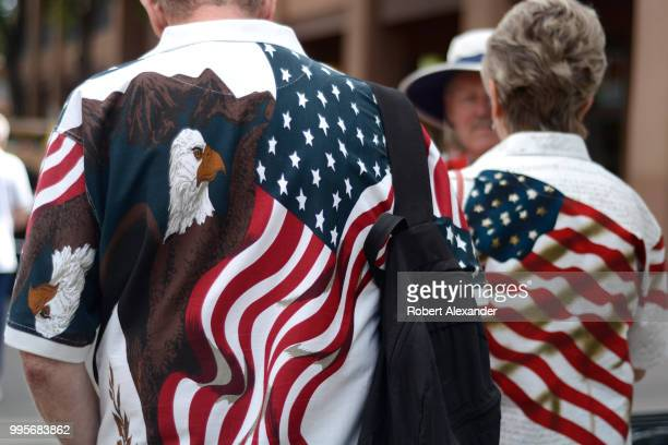 A man and woman wearing patriotic 'stars and stripes' shirts enjoy a Fourth of July holiday celebration in Santa Fe New Mexico