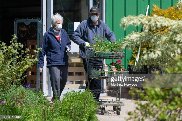 A man and woman wearing surgical face masks leave Caerphilly Garden Centre on May 11 2020 in Cardiff United Kingdom Wales' First Minister Mark...