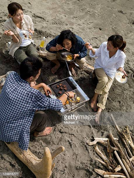 Man and woman who eat a barbecue happily