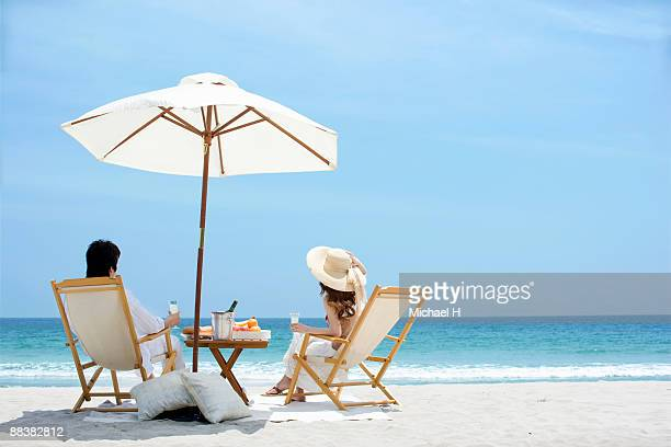 Man and woman who enjoys vacation on beach