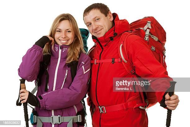 mann und frau mit rucksäcken - jacke stock-fotos und bilder