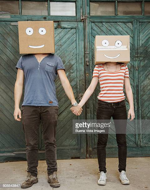 Man and woman with box on their heads