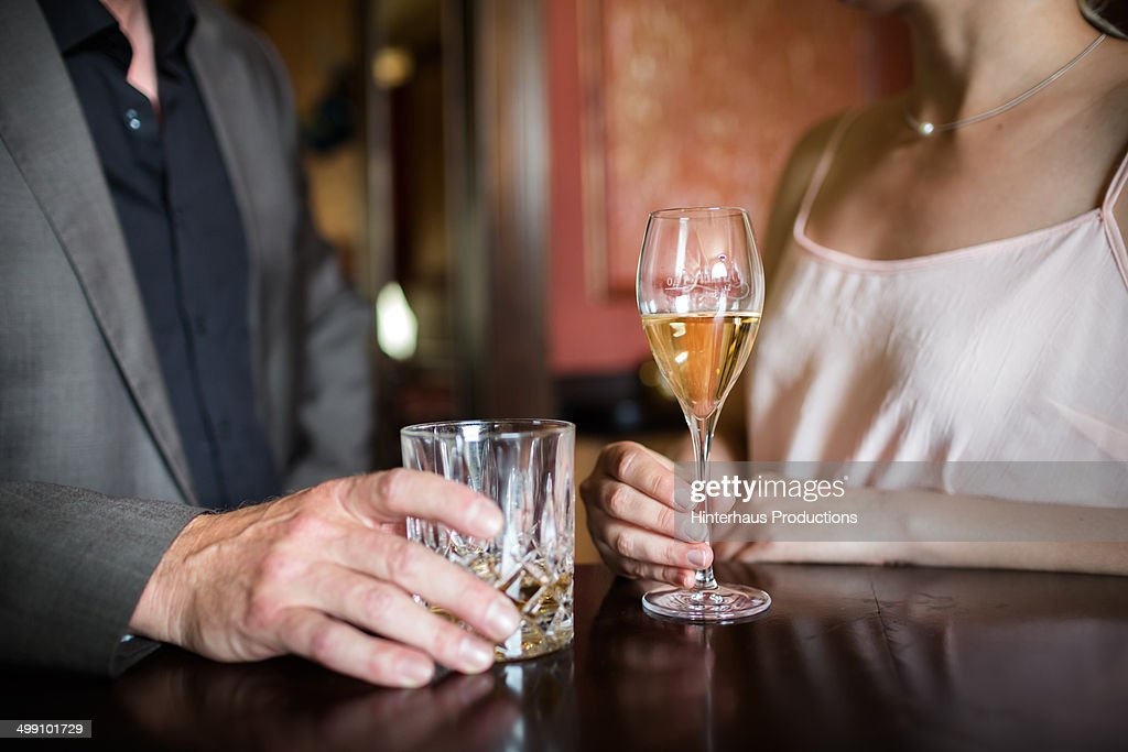 Man And Woman With Drinks : Stock Photo