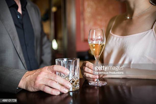 man and woman with drinks - mid section stock photos and pictures