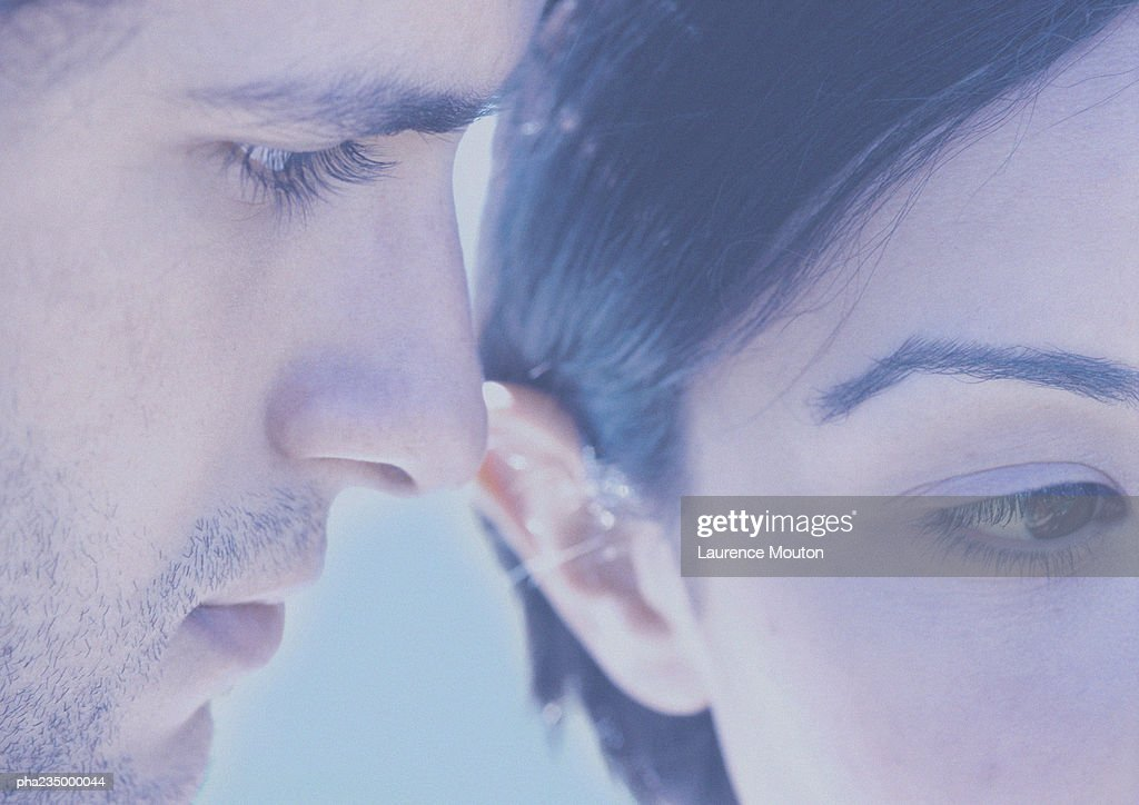 Man and woman with faces next to each other, close up, blurred, faded. : Stockfoto