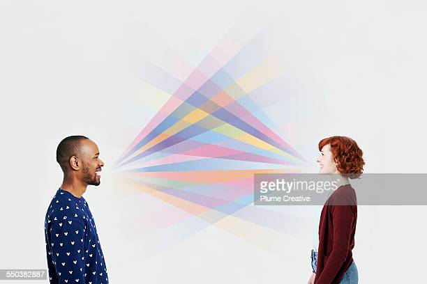 Man and woman with illustrated colorful rays