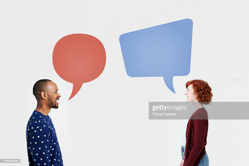 Man and woman with illustrated speech bubbles : Stock Photo