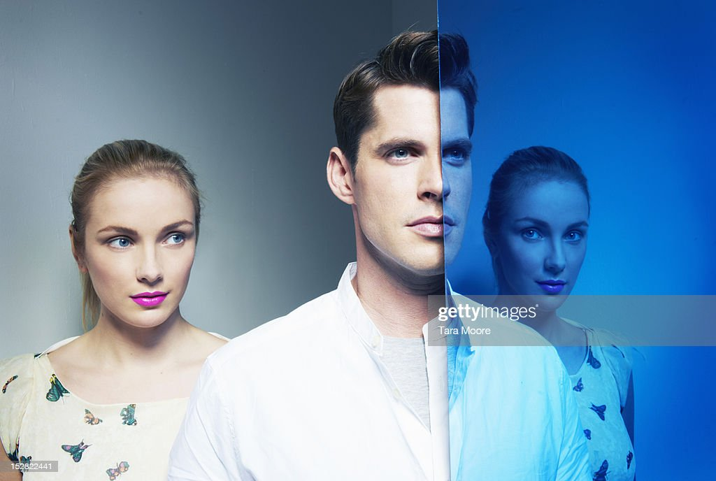 man and woman with mirror image : Stock Photo