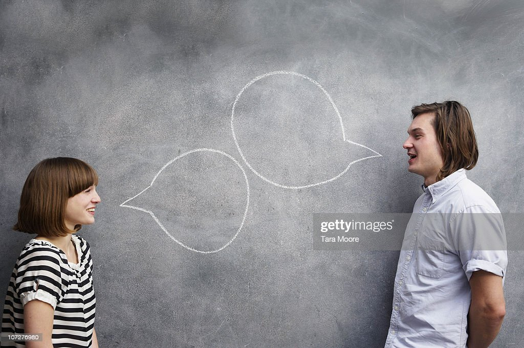 man and woman with speech bubbles on chalk board : Stock Photo