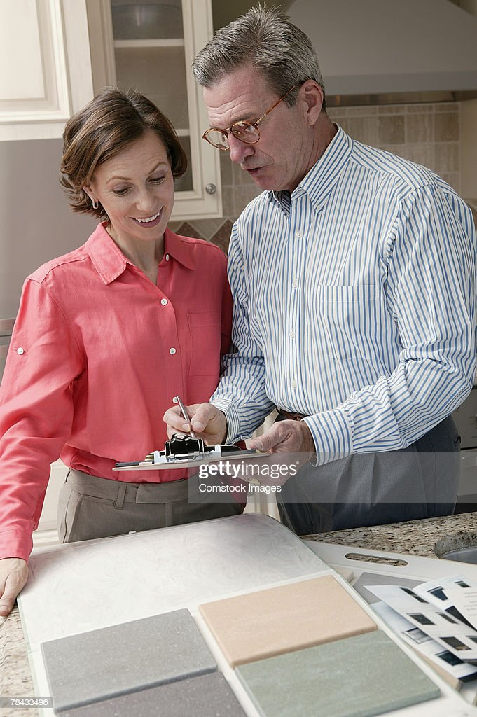 Man and woman with tile samples : Stock Photo